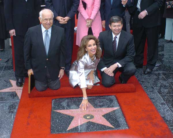 "<div class=""meta ""><span class=""caption-text "">Actress Susan Lucci is flanked by the Honorary Mayor of Hollywood Johnny Grant, left, and Hollywood Chamber of Commerce, President/CEO Leron Gubler, right, during the ceremony where she received a star on the Hollywood Walk of Fame, Friday, Jan. 28, 2005, in the Hollywood section of Los Angeles, Calif.  ((AP Photo/Phil McCarten) )</span></div>"